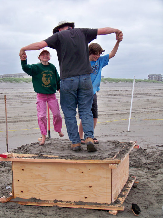 Packing sand with helpers.